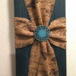 Handmade wall hanging in blue with burlap cross.