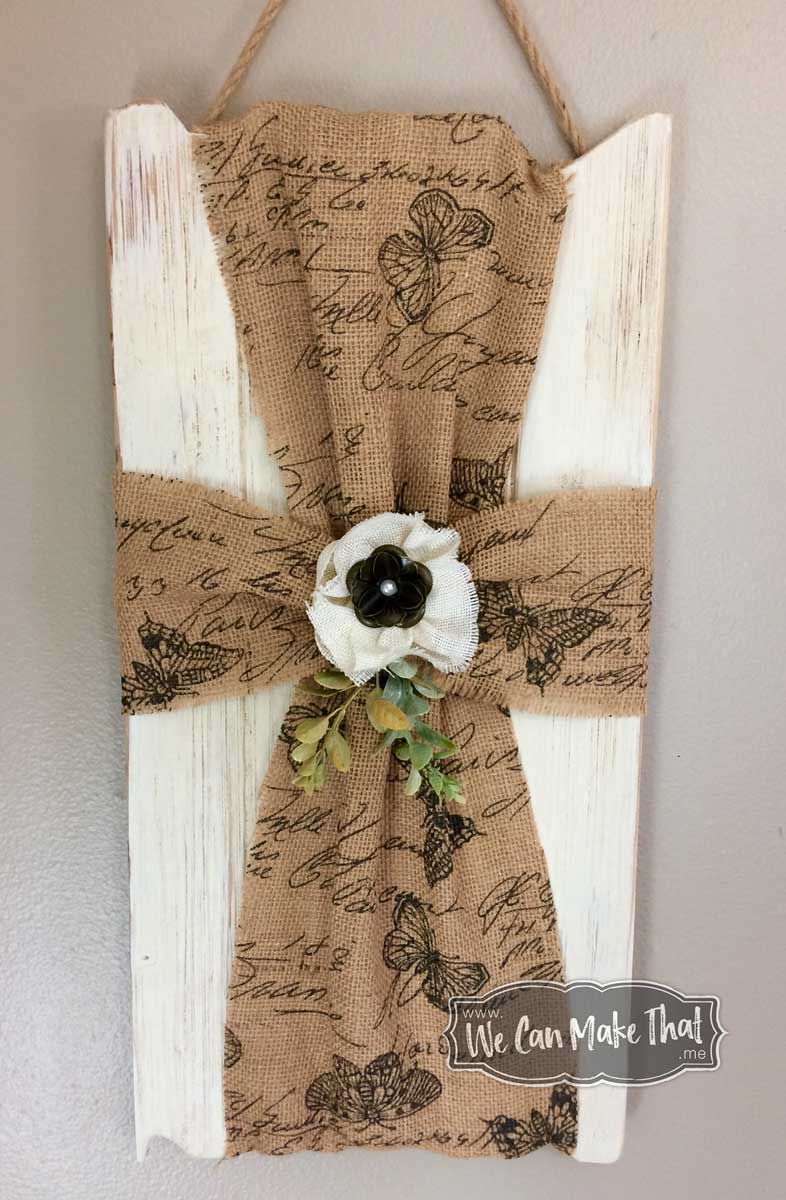 Handmade cross wall hanging with burlap and whitewashed wood